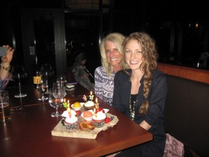 Kelly Childs and Erinn Weatherbie smiling after a delicious meal and a fun evening together