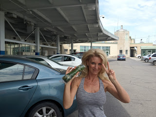 Kelly Childs at the airport with a dangerous collard wrap in hand!