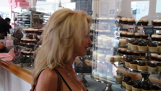 Kelly Childs admiring the selection that Georgetown Cupcakes has to offer