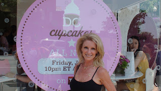 Kelly Childs standing in front of Georgetown Cupcakes