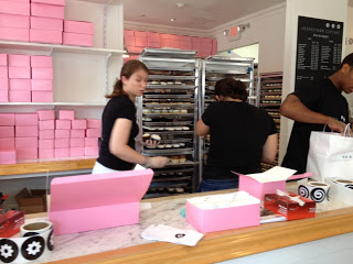 Workers rushing around Georgetown Cupcakes