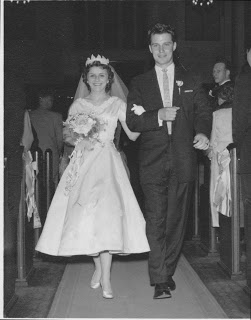 Colleen Childs and Russ Childs walking down the aisle together in 1956