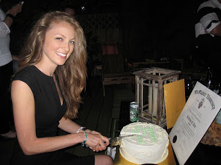 Erinn Weatherbie cutting into her graudation cake!