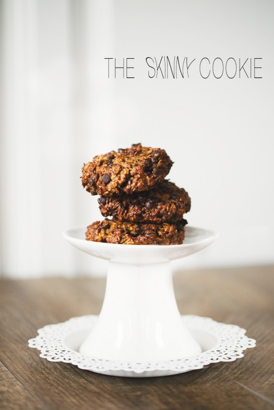 Skinny cookies piled high on a white pedestal