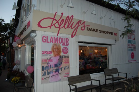 Kelly's Bake Shoppe at night with a party rocking on the inside