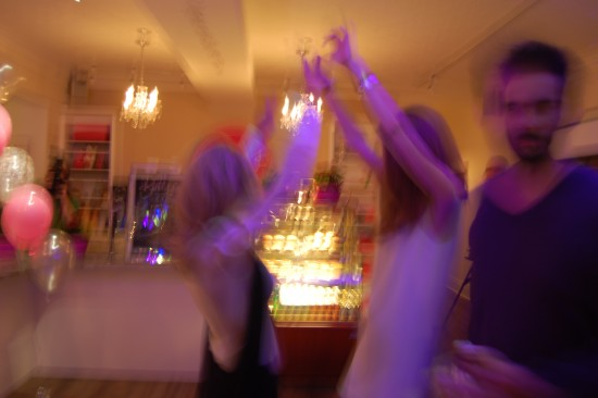 A very blurry picture of Kelly and Erinn dancing in the front of the bake shoppe