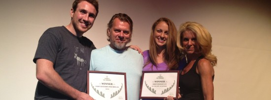 Michael Rennie, Ken Childs, Erinn Weatherbie, and Kelly Childs holding up their awards.