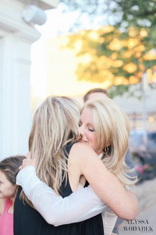 Kelly's Sister Shannon giving Kelly Childs a big hug