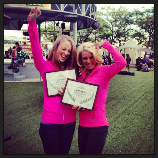 Erinn Weatherbie and Kelly Childs wearing pink and celebrating their big win at the Toronto Vegetarian Food Festival