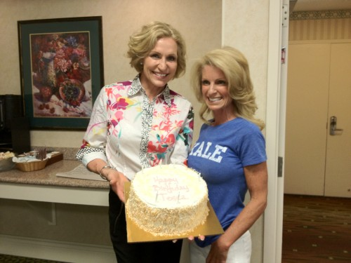 Tosca Reno holding up a cake with Kelly Childs