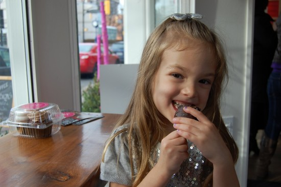 Young girl enjoying a cupcake at Kelly's Bake Shoppe