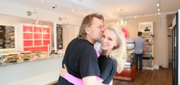 Kelly Childs being kissed by her husband Ken at the grand opening of Kelly's Bake Shoppe