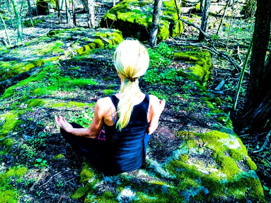 Kelly Meditating in the forest