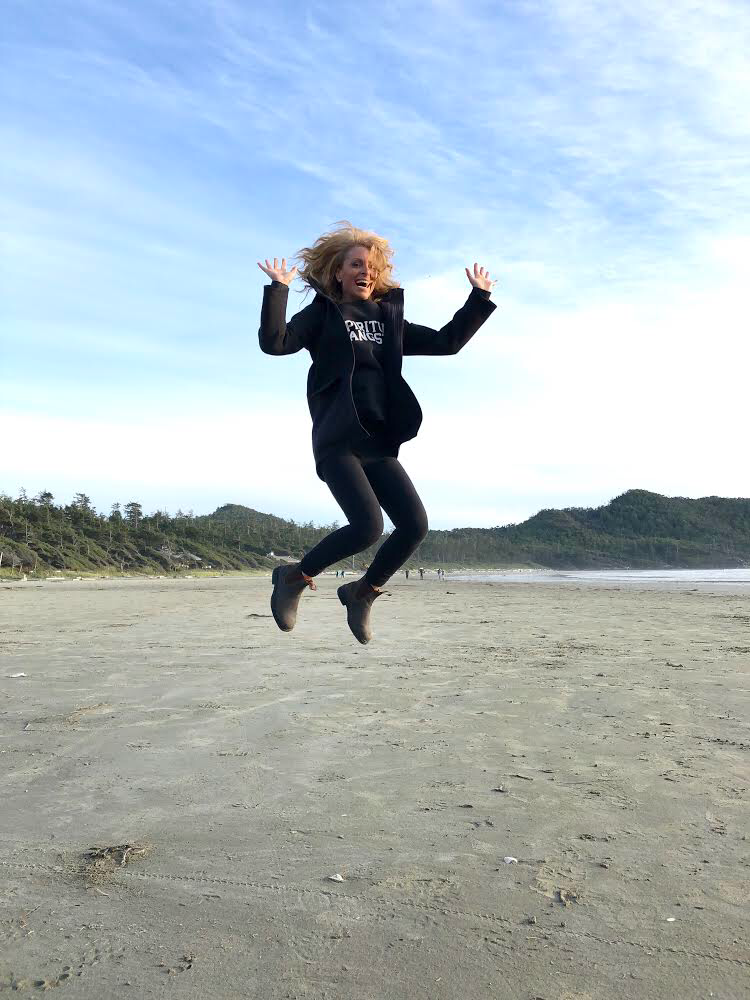 Kelly Childs in Tofino Jumping on Beach